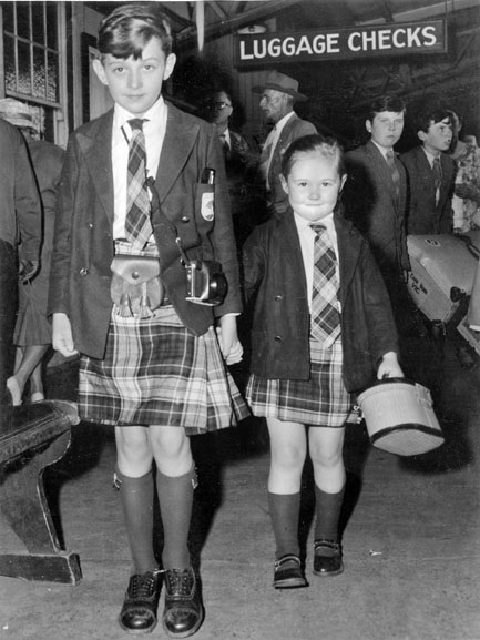 Harry, 10, and his sister Angela, 5, arrive in Brisbane as part of a party of 103 British immigrants, 30 September 1960